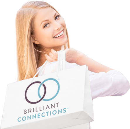 A smiling woman holding a SkinMedica shopping bag